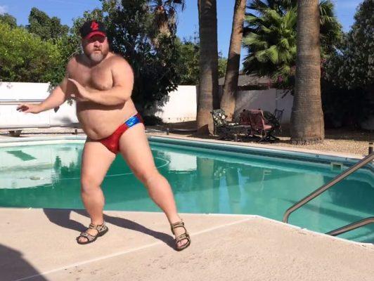 fat-guy-by-pool-532x400